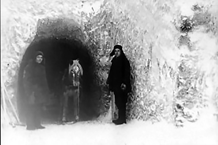 Workers in front of the first tunnel of the storage built manually in permafrost